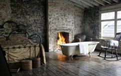 omg bathtub next to a fireplace, score
